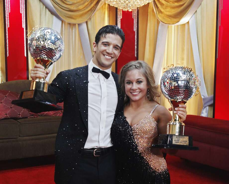 And now for the rest of the contestants. Shawn Johnson is seen here with her professional partner, Mark Ballas, as they old their trophies during Dancing with the Stars finale show in Los Angeles.  (Kelsey McNeal / Associated Press)