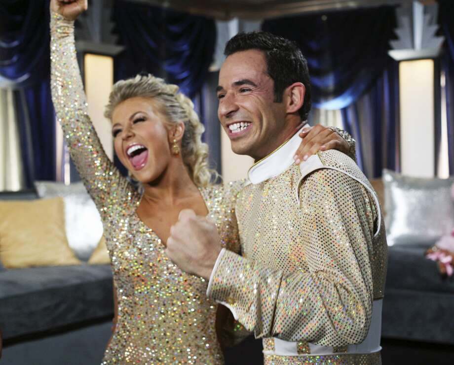 Helio Castroneves, right, with his then-partner Julianne Hough. (CAROL KAELSON / Associated Press)