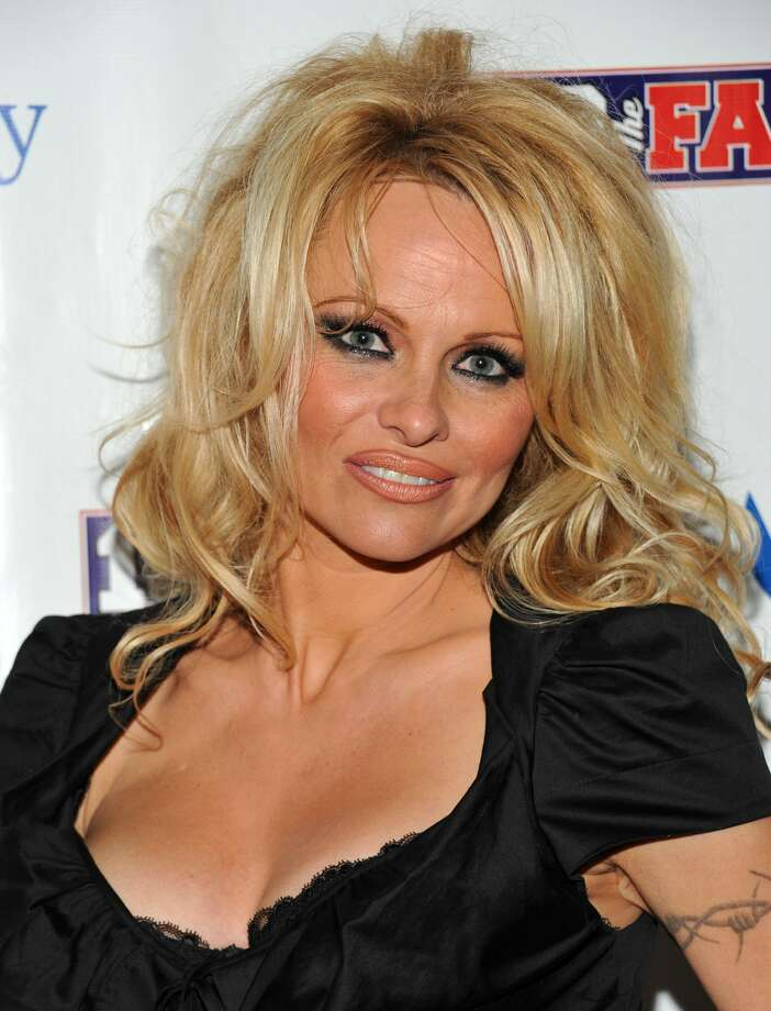 Actress Pamela Anderson arriving to host the Dallas SuperBash 2011 Super Bowl party at the Fashion Industry Gallery in Dallas, Texas.  (Evan Agostini / Associated Press)