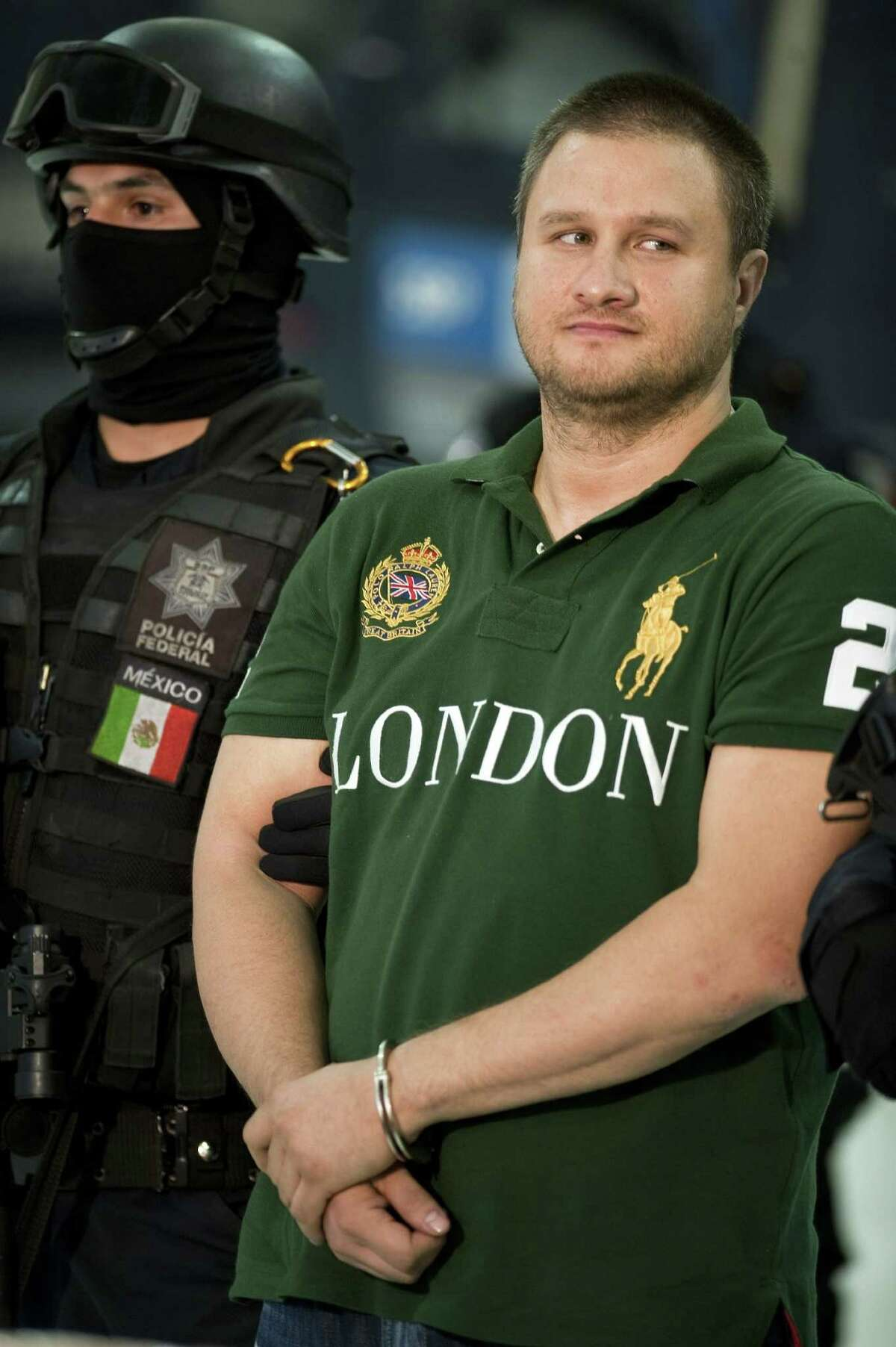 Edgar Valdez Villareal aka 'La Barbie' of the Beltran Leyva drug cartel, is presented to the press at the Federal Police headquarters in Mexico City, on August 31, 2010. Mexican authorities on Monday announced the capture of one of the country's most sought after drug kingpins, US-born Valdez Villarreal, known as 'the Barbie' for his fair complexion. Valdez was detained in a police operation in central Mexico, following intelligence work which began in June 2009. The 37-year-old was a key lieutenant of Arturo Beltran Leyva, who headed the cartel that bears his name and was Mexico's third most-wanted man until his December 2009 death in a military operation. AFP PHOTO/Alfredo Estrella