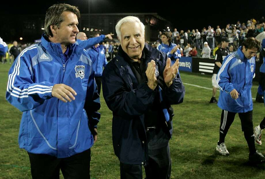 Earthquakes head coach Frank Yallop (left), walking off the field with owner Lew Wolff, brings out the best in his players. Photo: Jeff Chiu, AP
