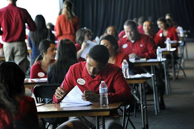 Target employees sit at rows of tables to interview the job seekers. The store is looking for 300 hourly workers. Photo: Michael Short, Special To The Chronicle
