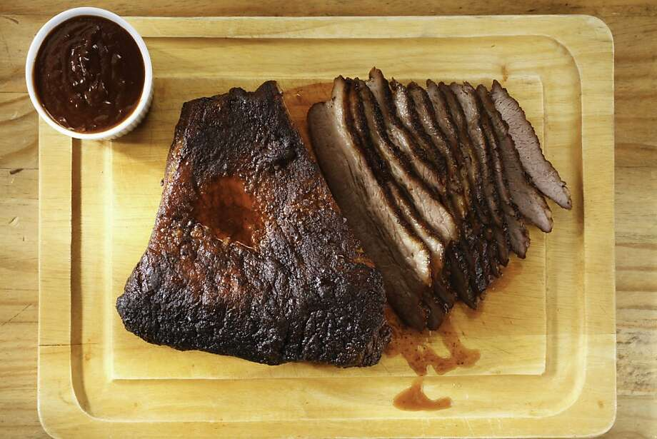 If you have a smoker, try smoking some brisket this weekend. This recipe includes a spicy dry rub and sweet BBQ sauce. Photo: Craig Lee, Special To The Chronicle