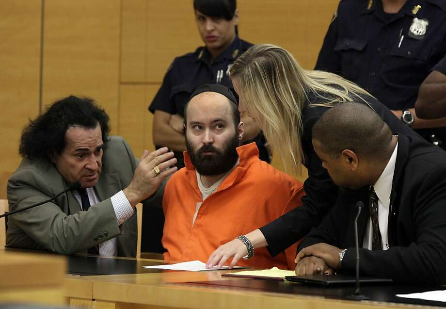 Levi Aron (center) confers with attorneys as he pleads guilty to kidnapping and murder. Photo: Richard Drew, Associated Press