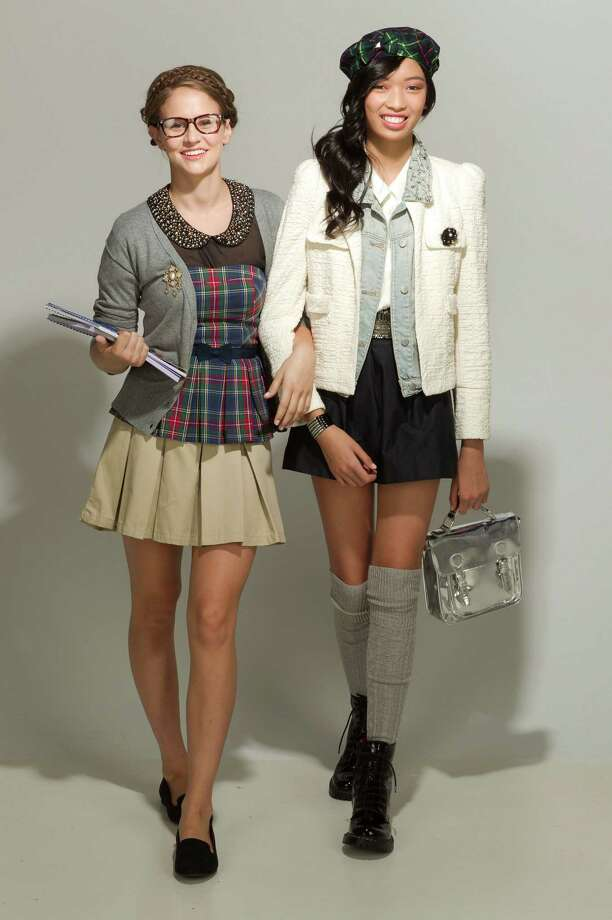 Erin Barr, left, wears a cardigan, $29, Urban Outfitters; a Mossimo skirt, $19 and Cherokee peplum top, $14, from Target; vintage brass brooch, $38, Abercrombie & Fitch; and slippers, $21, Target.  Lauren Nguyen wears a cream jacket, $129, Zara; vest, $218; a short pleated skirt, $18 (check your dress code), Forever 21; combat boots, $38, Target;  Alice & Olivia brooch, $125, Neiman Marcus; and crystal studded belt, $125, Urban Outfitters. Photo: James Nielsen / © Houston Chronicle 2012