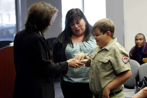 City Clerk Leticia Vacek holds a bowl of numbers as Celeste Montez-Tidwell watches her son Boston Tidwell, 9, draw a number for her place on the ballot.  Montez-Tidwell is running for City Council District 10. City Council candidates drew straws, numbers from a bowl, on Monday March 4, 2013 to determine the order in which their names will appear on the May 11 ballot. Photo: Helen L. Montoya, San Antonio Express-News / ©2013 San Antonio Express-News