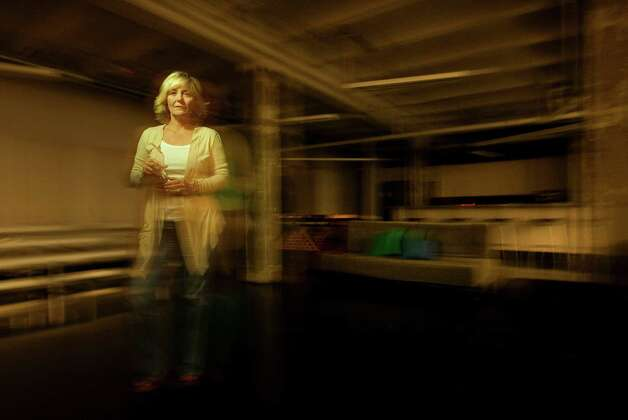 Standing in the basement, which she said had the most ghostly activity, Kristy Sexton, founder and CCO of Adcetera, says the building that his home to the marketing & advertising firm is haunted by a female ghost Tuesday, Aug. 7, 2012, in Houston.  Sexton hired a paranormal investigator to help them prove that the space is haunted. ( Johnny Hanson / Houston Chronicle ) Photo: Johnny Hanson / © 2012  Houston Chronicle