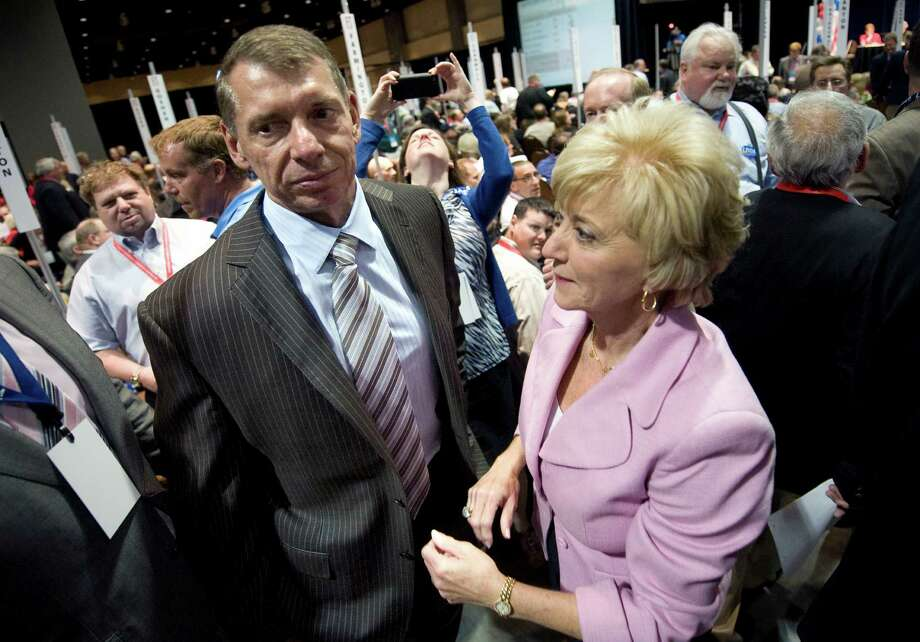 Vince McMahon, left, stands with his wife, Republican candidate for U.S. Senate Linda McMahon, right, at the Republican state convention in Hartford, Conn., May 18, 2012.  (AP Photo/Jessica Hill) Photo: Jessica Hill, Associated Press / AP2012