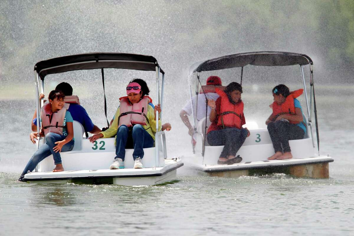 Hit the water in a pedal boat at Hermann Park's McGovern Lake. (Mayra Beltran / Houston Chronicle)