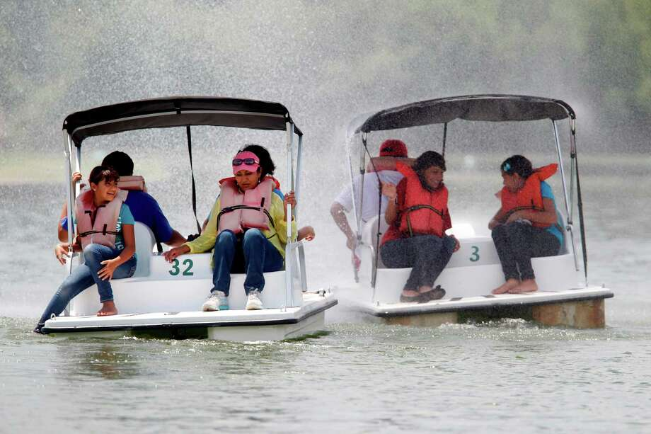 Hit the water in a pedal boat at Hermann Park's McGovern Lake. (Mayra Beltran / Houston Chronicle) Photo: Mayra Beltran / © 2012 Houston Chronicle