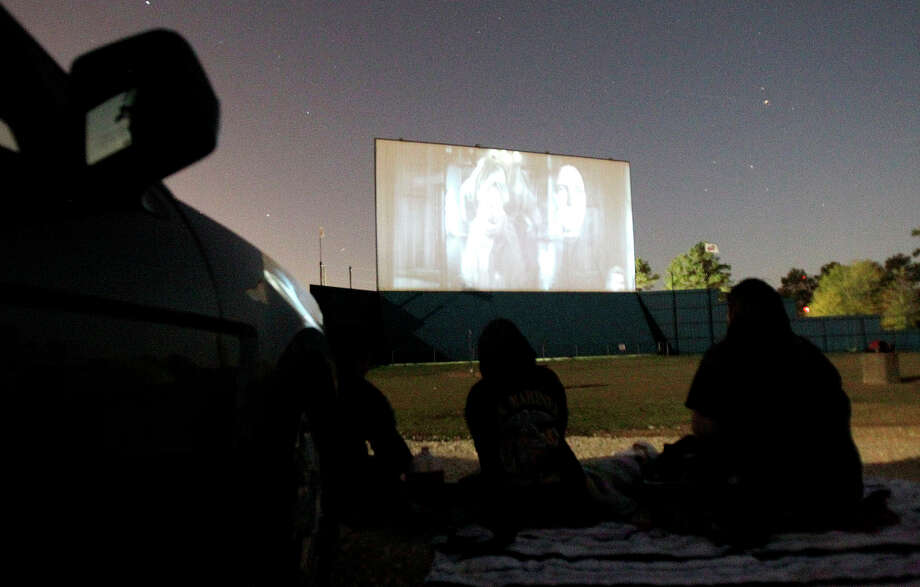 Families gather to watch a film at the Showboat Drive-In which has been in operation since 2006. Photo: Julio Cortez / Houston Chronicle