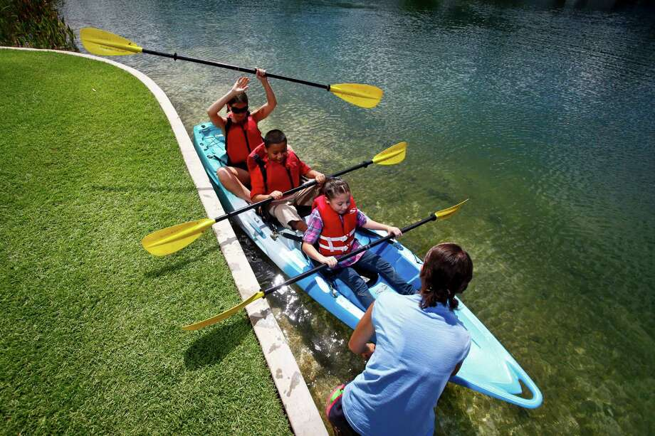 Make your way across Discovery Green's Kinder Lake on a kayak.