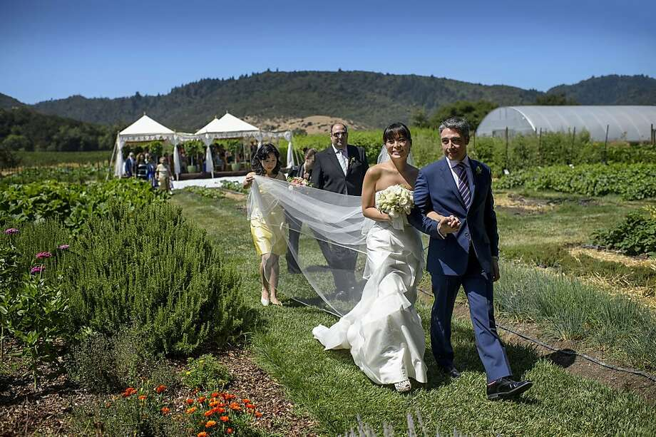 Jennifer Fukui and Greg Castells had their wedding on the grounds of the French Laundry, where they met when he was the restaurant's head sommelier and she was director of special events for Thomas Keller's California properties. Photo: Chrismanstudios.com, Agency
