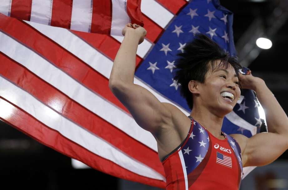 Clarissa Kyoko Mei Ling Chun of the United States celebrates after her win against Irini Merleni of Ukraine in their 48-kg women's freestyle wrestling bronze medal match at the 2012 Summer Olympics, Wednesday, Aug. 8, 2012, in London.  (Paul Sancya / Associated Press)