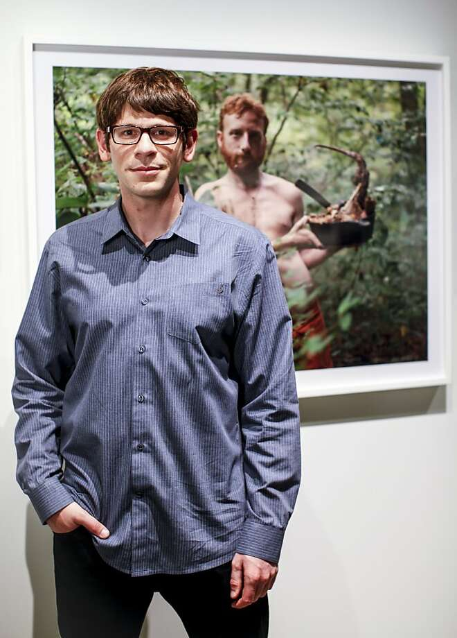 "Foglia in front of his photograph ""Acorn With Possum Stew, Wildroots Homestead, North Carolina,"" which hangs in the ""About Face"" exhibition at Pier 24 in S.F. Photo: Russell Yip, The Chronicle"