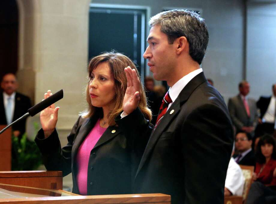 New council members Ron Nirenberg and Shirley Gonzales were sworn in Thursday June 20, 2013 and took their places on the dais as part of the 2013-15 City Council. Nirenberg and Gonzales are replacing Reed Williams and David Medina, respectively. Photo: Helen L. Montoya, San Antonio Express-News / ©2013 San Antonio Express-News