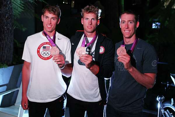 LONDON, ENGLAND - AUGUST 08:  (L-R) U.S. Olympians Scott Gault, Glen Ochal and Charlie Cole visit the USA House at the Royal College of Art on August 8, 2012 in London after winning the bronze in men's rowing four.  (Photo by Joe Scarnici/Getty Images for USOC)