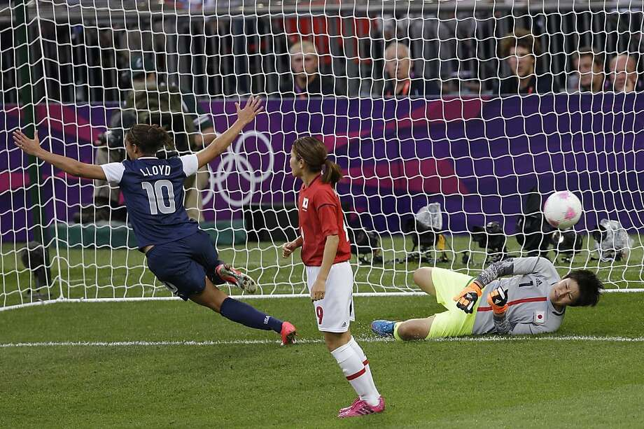 Carli Lloyd celebrates one of her two scores against goalkeeper Miho Fukumoto (right) and Japan in the Olympic final. Photo: Andrew Medichini, Associated Press