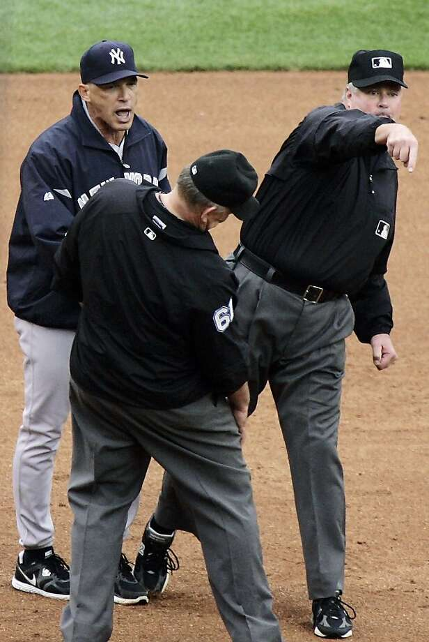 New York Yankees manager Joe Girardi, left, is tossed by third base umpire Tim Welke, right, after arguing about a double by Detroit Tigers' Andy Dirks that hit down the left field line in the fifth inning. Photo: Duane Burleson, Associated Press
