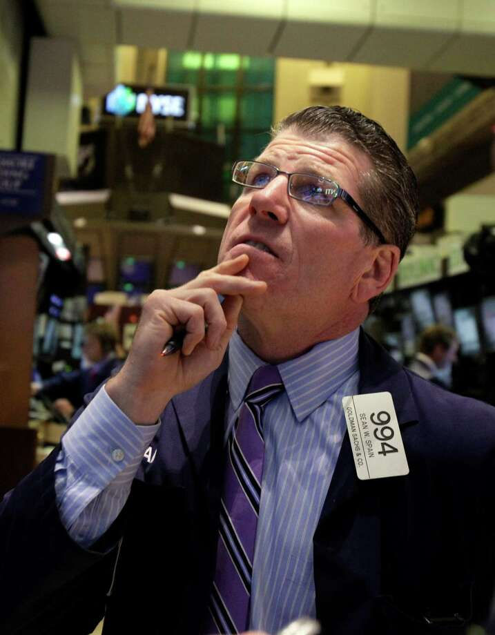 FILE -- A July 26, 2012 file photo shows trader Sean Spain working on the floor of the New York Stock Exchange. A stock market rally lost steam Wednesday Aug. 8, 2012 after mixed earnings from U.S. companies added to fears about Europe's economic slowdown.   (AP Photo/Richard Drew/file) Photo: Richard Drew