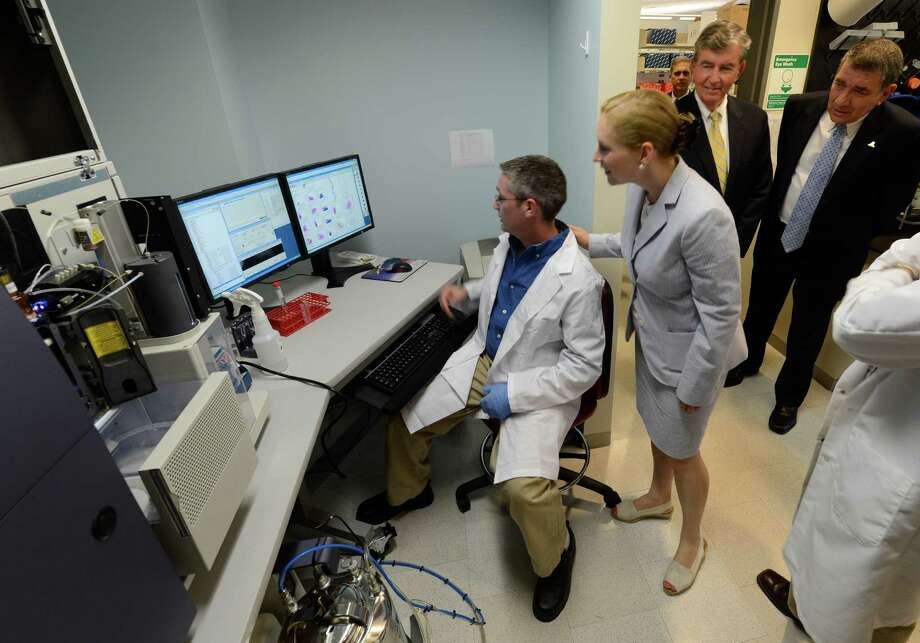 Senator Kirsten Gillibrand, center tours the Cancer Reearch Center in Rensselaer, N.Y. August 9, 2012.  Senator Gillibrand was accompanied by State Senator Neil Breslin, second from right and President George Philip of SUNYA, right.  At the console giving the Senator an explanation of the cell sorter is Steve Lotz, Research Tech.    (Skip Dickstein/Times Union) Photo: Skip Dickstein / 00018792A