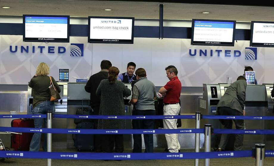 "United passengers check in at San Francisco International Airport in July. The airline says ""we are taking immediate action"" to deal with performance issues. Photo: Justin Sullivan / 2012 Getty Images"