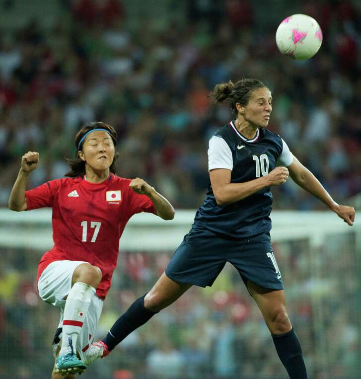 United States' Carli Lloyd (10) wins a header against Japan's Yuki Ogimi during the women's soccer gold medal match at the 2012 London Olympics on Thursday, Aug. 9, 2012. The USA won the game 2-1 to claim the gold medal. ( Smiley N. Pool / Houston Chronicle )