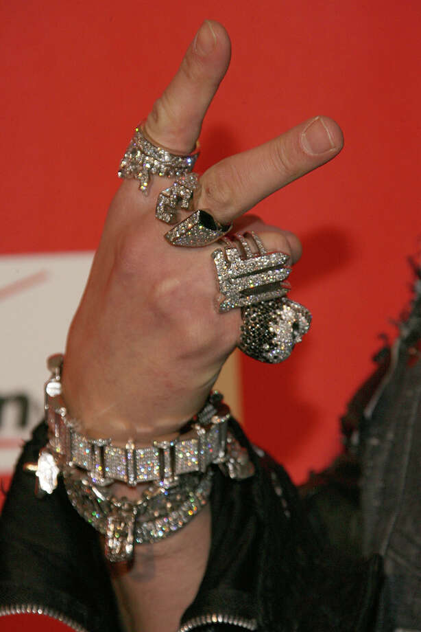 "Bling (n): Expensive, ostentatious clothing and jewelry. ""His bling is ostentatious."" Photo: Contributed Photo, Getty Images / Getty Images"