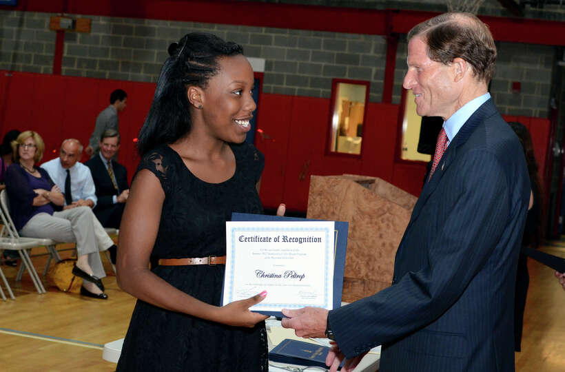 Sen. Richard Blumenthal congratulates Christina Peltrop as she graduates from the Let's Get Ready pr