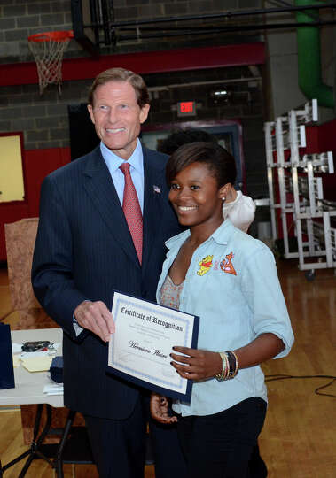 Sen. Richard Blumenthal congratulates Hermione Illaire as she graduates from the Let's Get Ready pro