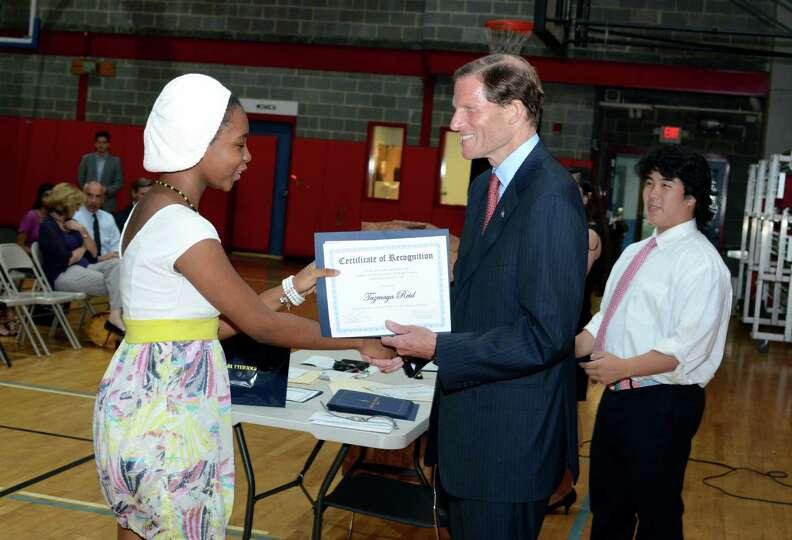 Sen. Richard Blumenthal congratulates Tazmaya Reid as she graduates from the Let's Get Ready program