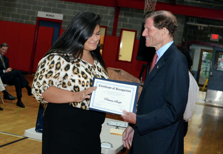 Sen. Richard Blumenthal congratulates Patricia Swope as she graduates from the Let's Get Ready progr