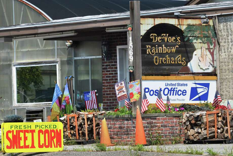 Sign at DeVoe?s Rainbow Orchards on Route 9, in Halfmoon announcing a new Contract Postal Unit there Thursday Aug. 9, 2012. (John Carl D'Annibale / Times Union) Photo: John Carl D'Annibale / 00018730A