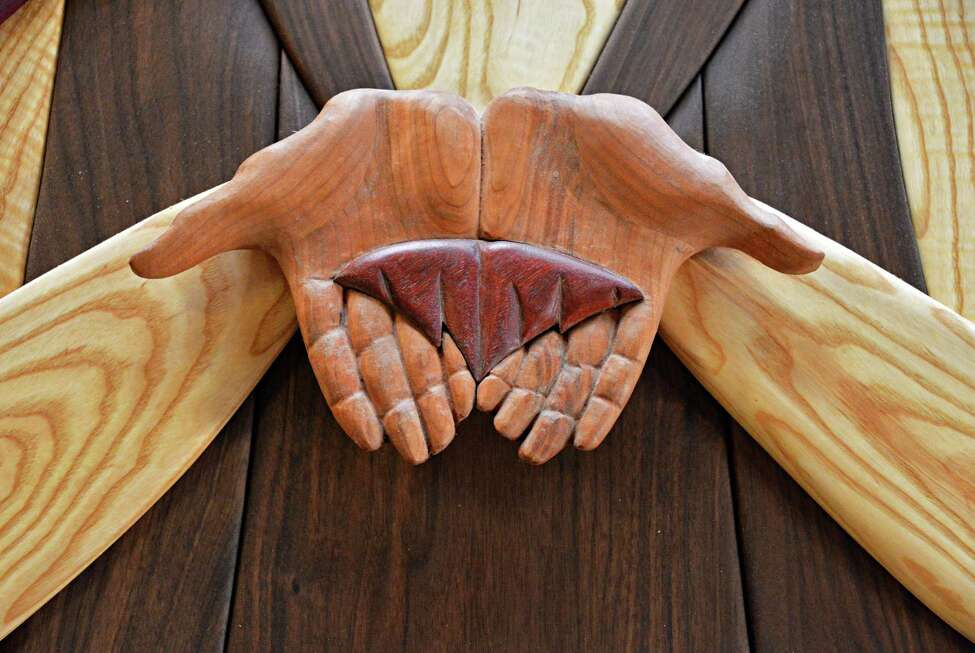 Detail of the praying hands of the Blessed Virgin Mary by sculptor and wood worker Jim Lewis for the largest piece of work he has ever made, a 23 by 17 foot altar piece called a Crucifixion mural or retablo slated to go to a church in Edinburg, Texas, at his Troy studio Thursday Aug. 9, 2012. (John Carl D'Annibale / Times Union)