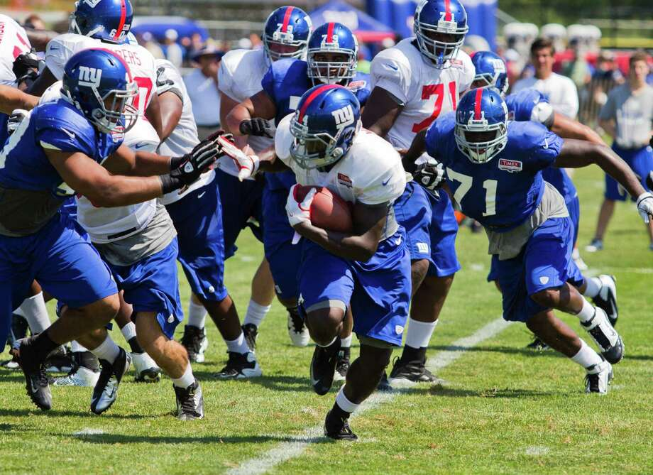 New York Giants running back #34 David Wilson breaks for a run to the outside during the preseason training camp at the University at Albany campus, Wednesday Aug. 8, 2012 in Albany, N.Y. (Dan Little/Special to the Times Union) Photo: Dan Little / Dan Little