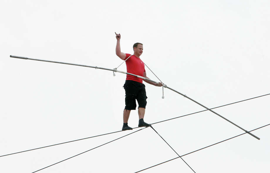 Daredevil Nik Wallenda performs his tightrope walk above the beach in Atlantic City, N.J. Thursday, Aug. 9, 2012. Wallenda successfully walked 1,300 feet along the wire while about 100 feet above the ground in front of the Atlantic Club Casino Hotel and the Tropicana Casino & Resort. (AP Photo/The Press of Atlantic City, Sean Fitzgerald) MANDATORY CREDIT Photo: Sean Fitzgerald / Press of Atlantic City