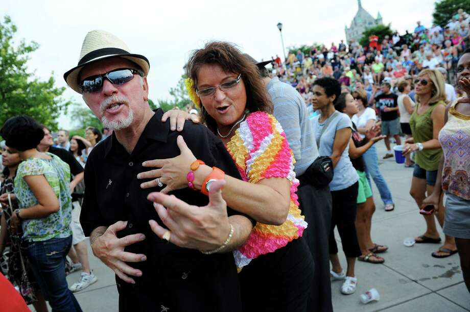 Tony Nero of Albany, left, and Deborah Scott of Columbia, Herkimer County, sing along to the music of the Beach Bums: A Tribute to The Beach Boys during the final concert of the Alive at Five series on Thursday, Aug. 9, 2012, at Riverfront Park in Albany, N.Y. (Cindy Schultz / Times Union) Photo: Cindy Schultz / 00018796A