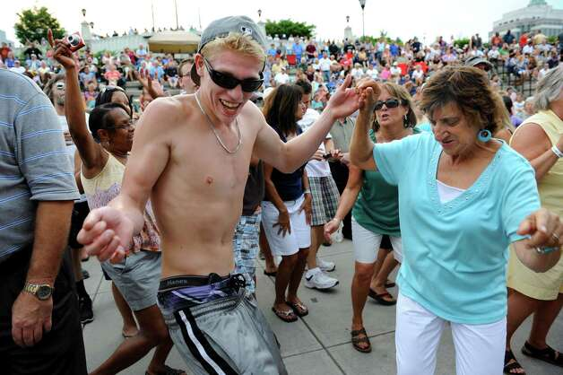 Brian Rand of Delmar, left, dances with Joan Ruf of Guilderland to the music of the Beach Bums: A Tribute to The Beach Boys during the final concert of the Alive at Five series on Thursday, Aug. 9, 2012, at Riverfront Park in Albany, N.Y. (Cindy Schultz / Times Union) Photo: Cindy Schultz / 00018796A