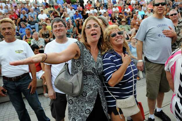 Kim Fisher of Colonie, left, and Kim Farinella of Poestenkill sing along to the music of the Beach Bums: A Tribute to The Beach Boys during the final concert of the Alive at Five series on Thursday, Aug. 9, 2012, at Riverfront Park in Albany, N.Y. (Cindy Schultz / Times Union) Photo: Cindy Schultz / 00018796A