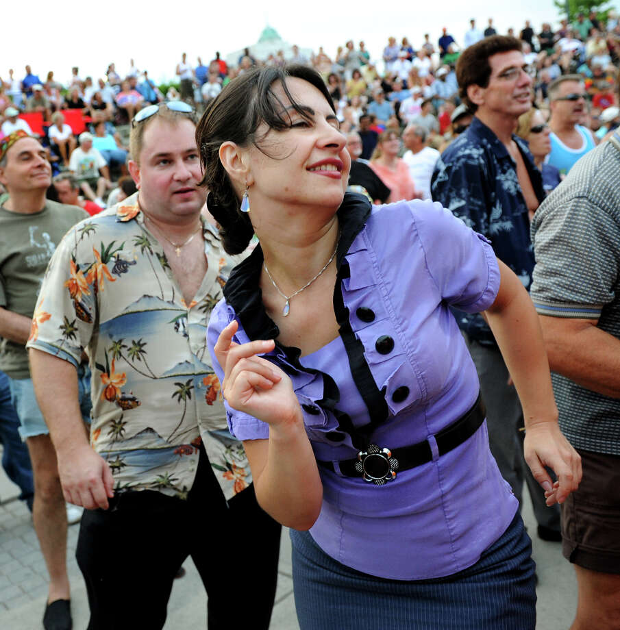 Alisa Serdyuk of Latham dances to the music of the Beach Bums: A Tribute to The Beach Boys performs during the final concert of the Alive at Five series on Thursday, Aug. 9, 2012, at Riverfront Park in Albany, N.Y. (Cindy Schultz / Times Union) Photo: Cindy Schultz / 00018796A