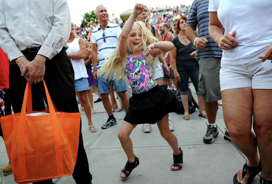 Marianna Loomis, 8, of East Greenbush dances to the music of the Beach Bums: A Tribute to The Beach Boys performs during the final concert of the Alive at Five series on Thursday, Aug. 9, 2012, at Riverfront Park in Albany, N.Y. (Cindy Schultz / Times Union) Photo: Cindy Schultz / 00018796A