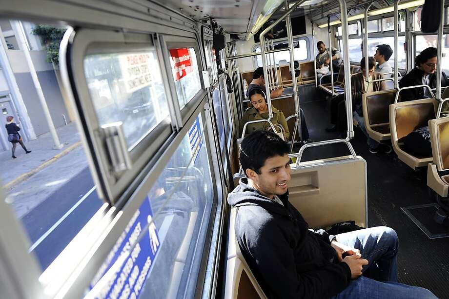 Software engineer Nirmam Sandesara takes the 83X-Mid-Market Express to Twitter on Market Street. Photo: Michael Short, Special To The Chronicle