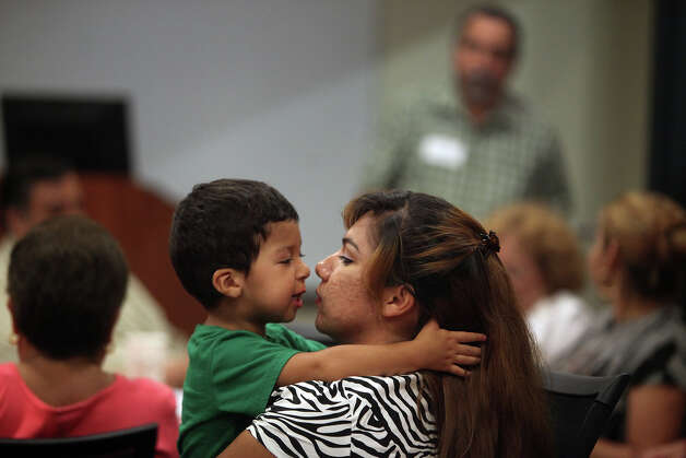 Erica Monreal, who lives in the apartments across from Haven for Hope, talks with her son, Isbac Monreal, 2, during the community meeting with San Antonio City Councilman David Medina at Haven for Hope on Thursday, August 9, 2012. Photo: Lisa Krantz, San Antonio Express-News / San Antonio Express-News