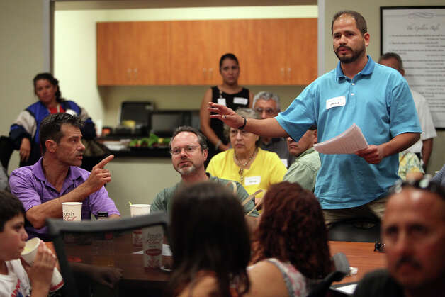 Roland Rangel, owner of Rangel's Bonding Service, shares the concerns of his group after they discussed the problems in their neighborhood during a breakout session during the community meeting with San Antonio City Councilman David Medina at Haven for Hope on Thursday, August 9, 2012. Photo: Lisa Krantz, San Antonio Express-News / San Antonio Express-News