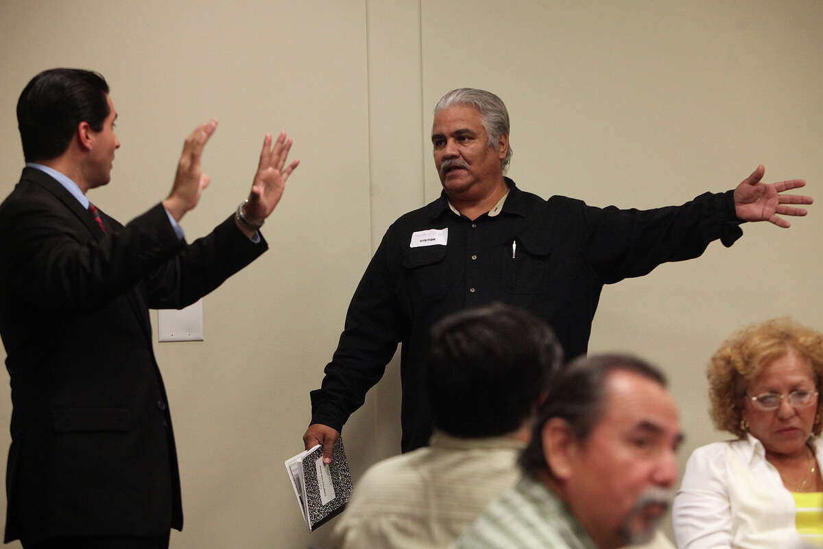 Abel Ruiz, right, complains to City Councilman David Medina, left, that the original Haven for Hope Neighborhood Advisory Council's concerns were not listened to when Haven for Hope was first built, during the community meeting with Medina at Haven for Hope on Thursday, August 9, 2012.
