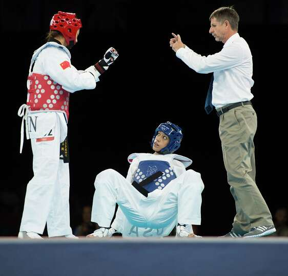Diana Lopez of the USA gets up from the mat during her women's -57kg preliminary round taekwondo bou