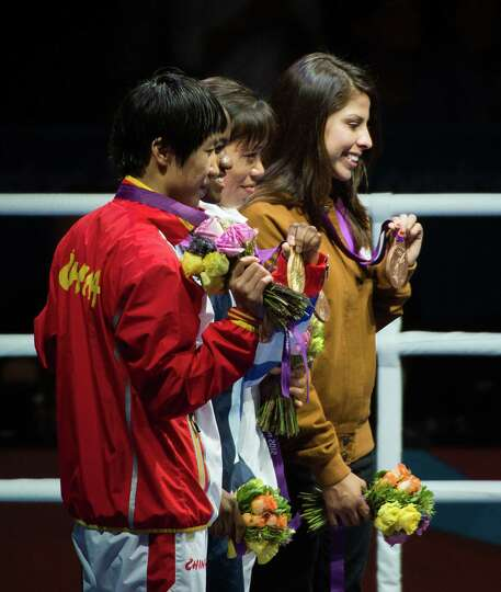 Boxer Marlen Esparza shows off her bronze medal for women's semifinal flyweight 51-kg boxing in an a