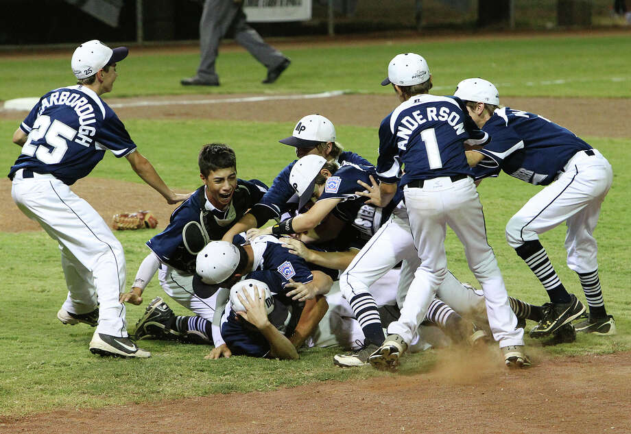 McAllister Park players pile onto pitcher Tyler Vitt after the last out in the sixth inning to defeat Lufkin. McAllister Park now moves on to the Little League World Series in Williamsport, Pa. Photo: Kin Man Hui, San Antonio Express-News / ©2012 San Antonio Express-News