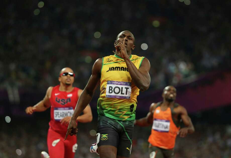 Usain Bolt, of Jamaica, reacts after winning the men's 200-meter final at the 2012 Summer Olympic Games in London, Aug. 9, 2012. (Jed Jacobsohn/The New York Times) Photo: JED JACOBSOHN / NYTNS