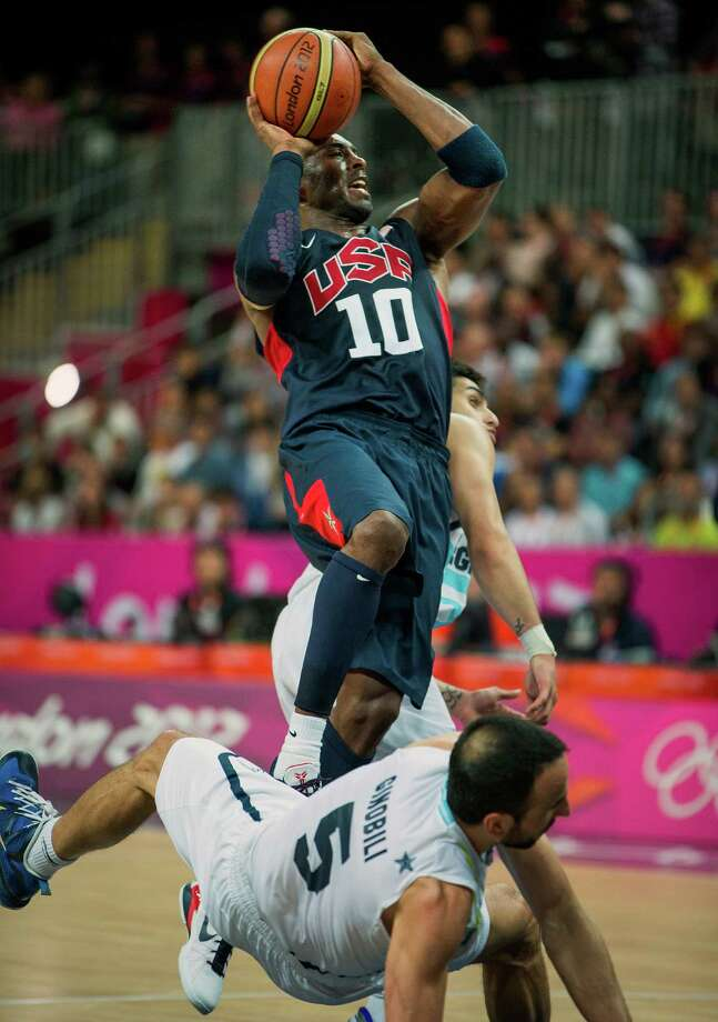 USA's Kobe Bryant drives to the basket over Argentina's Manu Ginobili during a men's basketball preliminary round match at the 2012 London Olympics on Monday, Aug. 6, 2012. ( Smiley N. Pool / Houston Chronicle ) Photo: Smiley N. Pool / © 2012  Houston Chronicle